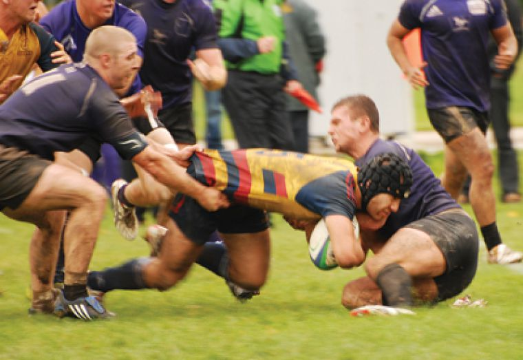 Gaels eight-man Pat Richardson drives for a try during the Gaels' Oct. 3 one-point win over the Mustangs in London.