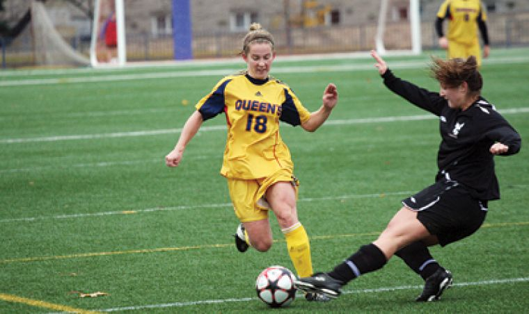 Midfielder Jennifer Hutchinson tries to avoid a challenge during the Gaels 3-1 OUA quarter-final win over the Carleton Ravens on Oct. 31 at Tindall Field.