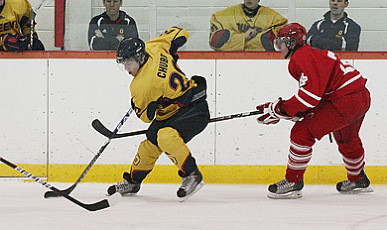 Forward David Chubb tries to negotiate his way through two Paladin defencemen during Wednesday's shootout loss.