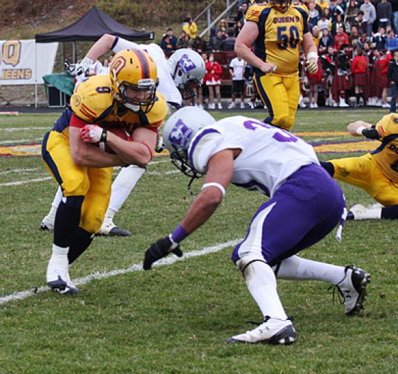 Running back Marty Gordon comes face-to-face with a Mustang defender during Saturday's Yates Cup win.