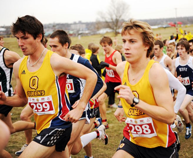 Clay Patterson (left) and Matt Hulse take off during Saturday's CIS cross-country final at Fort Henry Hill.
