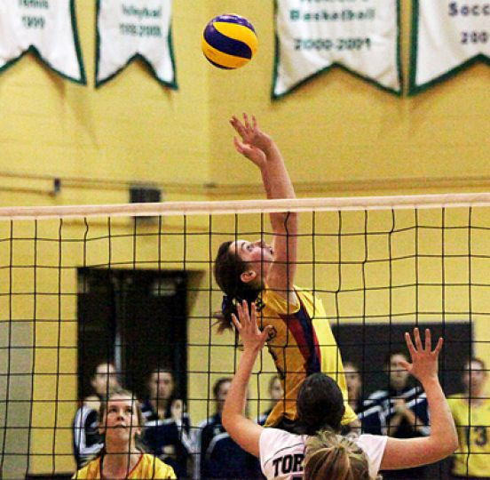 Second-year setter Julie Lockwood puts the ball up during Friday night's game against Toronto.