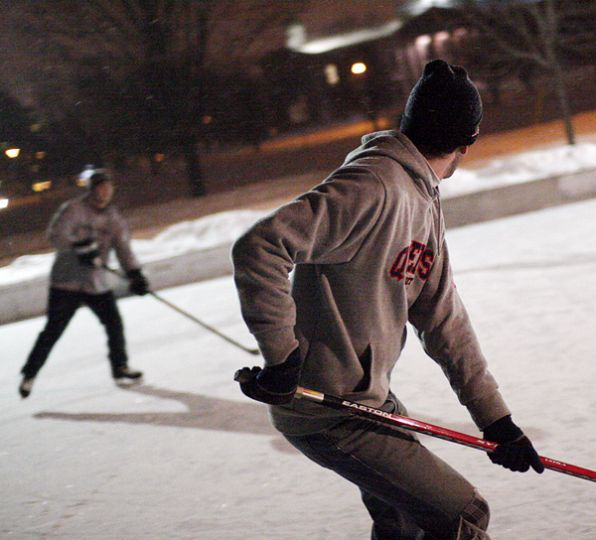 Students playing hockey at one of Kingston's several outdoor skating rinks last winter.