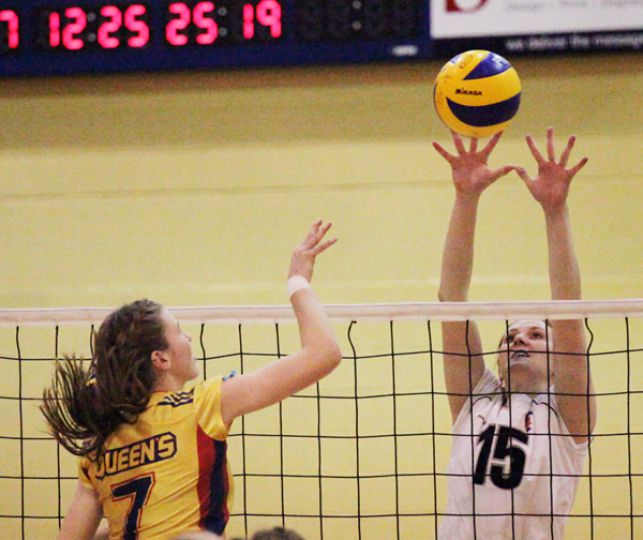 Women's volleyball middle hitter Colleen Ogilvie spikes the ball during the Gaels five-set win over the University of Toronto Varsity Blues on Nov. 20.