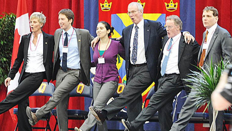 Dean of the School of Graduate Studies Janice Deakin, AMS President Michael Ceci, Rector Leora Jackson, Board of Trustees member Andrew Pipe, Board of Trustees Chair Bill Young and Principal Daniel Woolf dance the Oil Thigh at the Queen's Centre official opening ceremony last Friday.