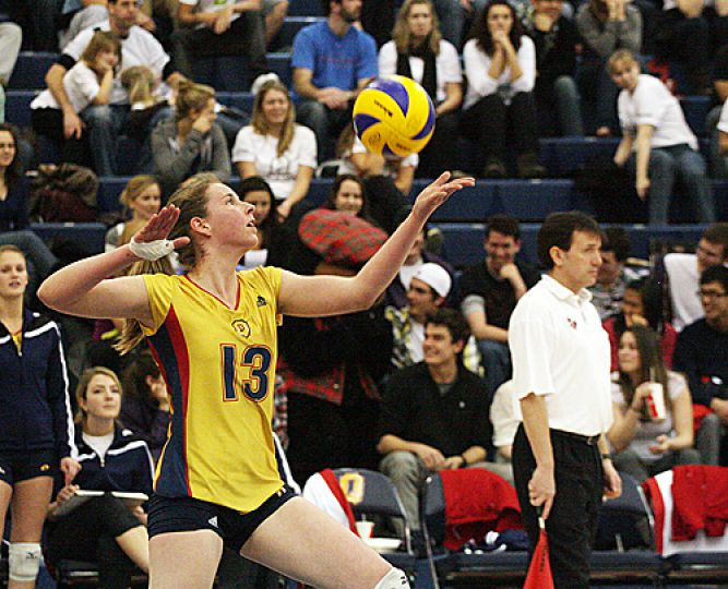 Middle hitter Katie Matthews serves during the first-ever game in the Queen's Centre ARC gym. Matthews had eight kills in the 3-2 win over the York Lions on Sunday.