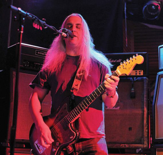 J. Mascis of Dinosaur Jr. plays during the band's concert at Ale House last night.