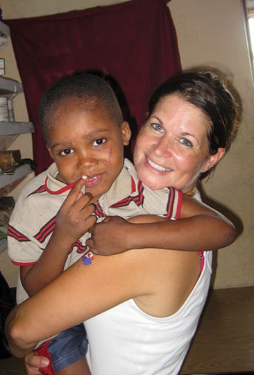 Tammy Babcock, pictured above in her most recent trip to Haiti, has been to the country once every two months since 2007.