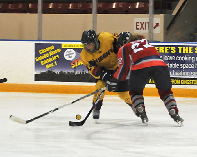 Captain Allison Bagg carries the puck during Queen's 2-1 win on Oct. 17 against the Brock Badgers at the Memorial Centre.