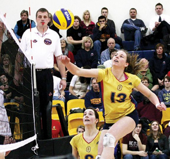 Middle hitter Katie Matthews saves a ball during Saturday's 3-2 win over the Brock Badgers at the ARC.