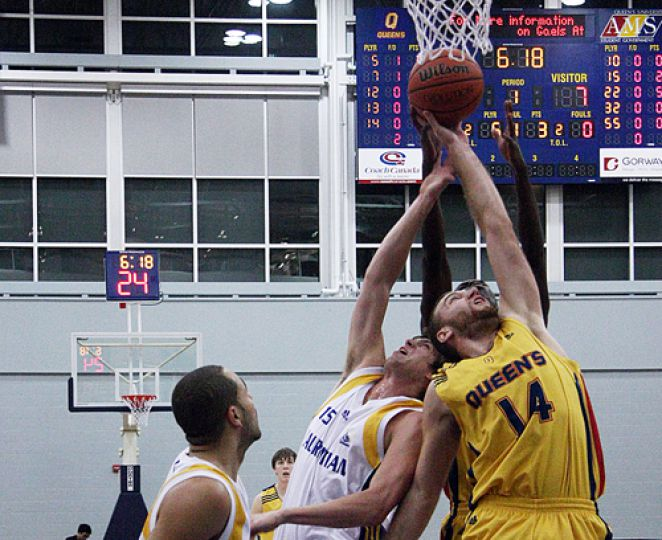 Men's basketball forward Mitch Leger brings down one of his 16 rebounds during the Gaels' 87-81 win over the Laurentian Voyageurs on Friday. For full game story, please see page 14.