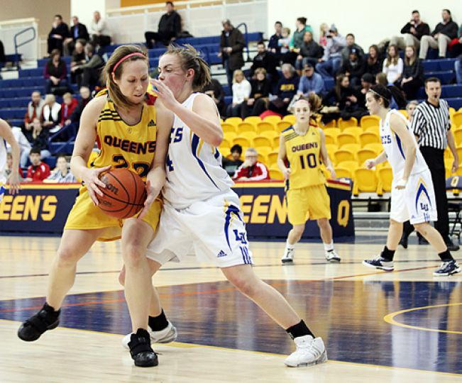 Gaels' wing Katie Guthrie fights off a Laurentian player during Friday's 64-62 win at the ARC.