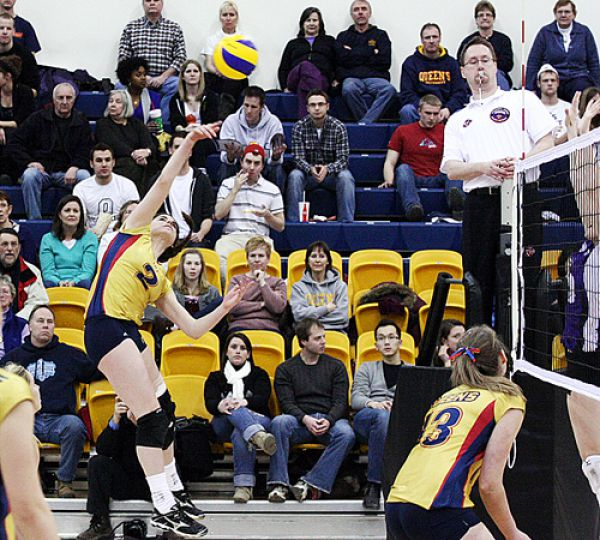 Outside hitter Elyssa Heller (2) spikes the ball during Friday's straight-sets win over the Western Mustangs at the Main Gym at the ARC. The Gaels are unbeaten at home this year.