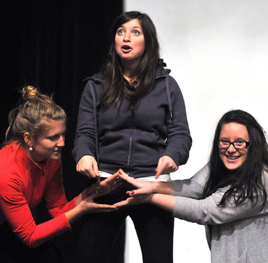 Cast members Lindsay Sample, Jessica Pearlstein and Shannon Goldberg perform the introduction to Queen's 10th production of The Vagina Monologues. For full story, see page 8.