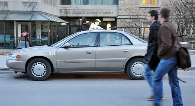 The sight of a taxicab waiting on University Ave. besides the JDUC is a familiar one for Queen's students.