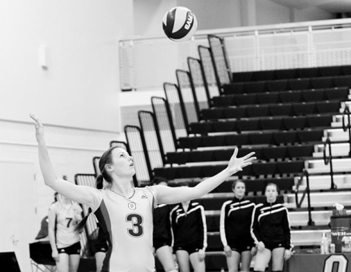 Setter Anna Pedjase serves the ball on Wednesday night against the Royal Military College Paladins. Pedjase led the Gaels with 18 assists.