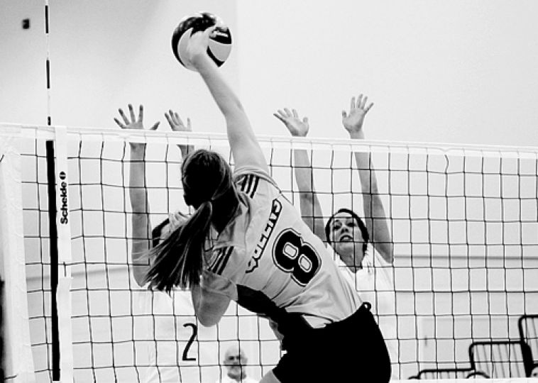 Outside hitter Allison Grand spikes the ball during Queen's straight-sets victory over the Paladins at the Main Gym on Wednesday night. Grand notched three kills and seven points against RMC.