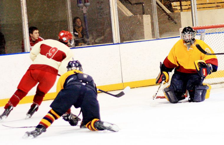 Goaltender Steele De Fazio makes a save during his shutout performance at last Thursday's Carr-Harris Cup. It was De Fazio's first shutout since he took over the starting job in the Gaels net.