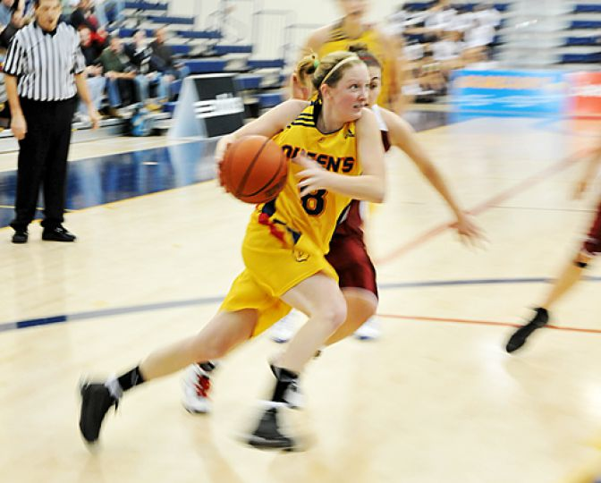 Guard Brittany Moore drives to the hole during the women's basketball team's 82-74 win over the Gee-Gees last weekend.