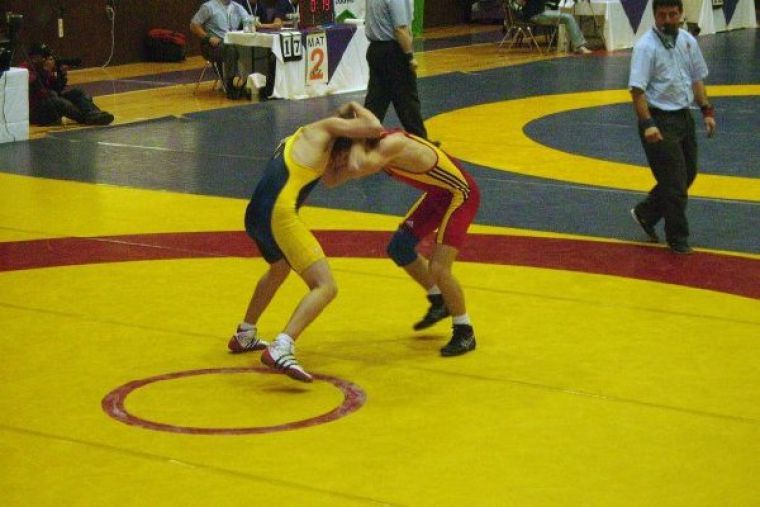 Queen's wrestler Joel Smith (left) wrestles Guelph's Scott Young during the OUA championships in London on Feb. 20.