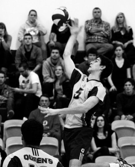 Gaels' middle hitter Joren Zeeman spikes the ball during Queen's straight-set win over the York Lions on Jan. 17. Zeeman was selected as a CIS Second-Team All-Canadian.