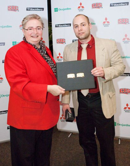 Curling skip Jonathan Beuk has curled for Queen's for seven years. He is pictured here being awarded his All-Canadian certification by a representative from the Canadian Curling Association last weekend.