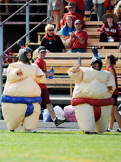 Students dressed in Athletics and Recreation's sumo suits compete at a Gaels football game earlier this year.