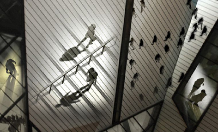 """Nuit Blanche invites Torontonians to experience and interact with a multitude of artistic installations like """"Crossings"""" (above) at the ROM and the Yorkville performance of artist Kent Monkman a.k.a. Miss Chief Eagle Testickle (below)."""