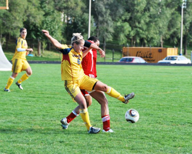 Meredith Raddysh, steals the ball from an RMC forward. Queen's Gaels won 6-0 moving them up to fifth in the nation.