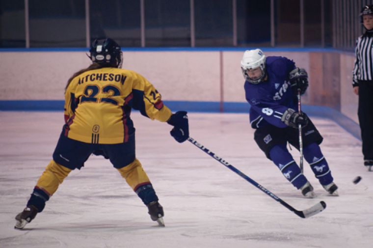 Defenceman Shelby Aitcheson defends against the Western offence during their 6-1 win Sunday night in London.