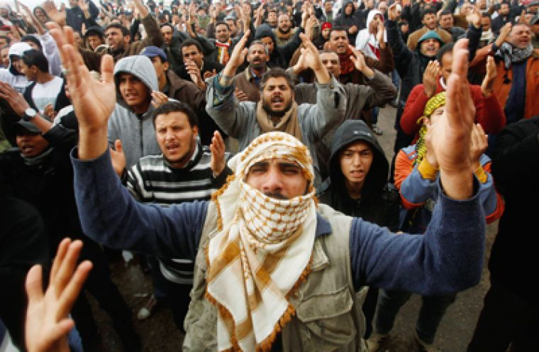 Thousands of protesters shout anti-Gaddafi slogans in the Libyan port town of Benghazi last week.