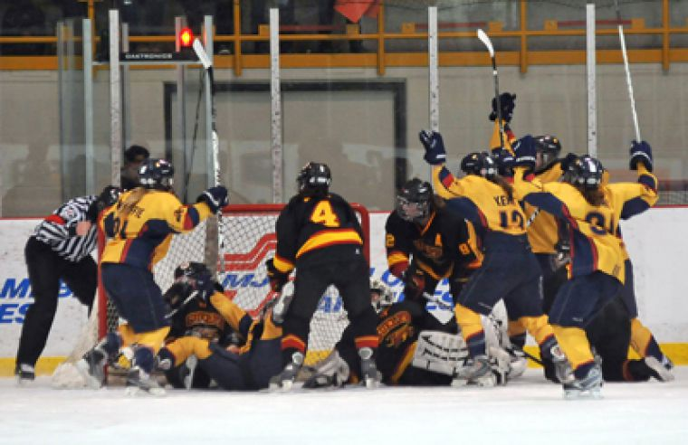 The Queen's Gaels celebrate a goal against the Guelph Gryphons in their 2-1 win on Wednesday night. The game ended in Guelph at 1 a.m. after six overtimes.