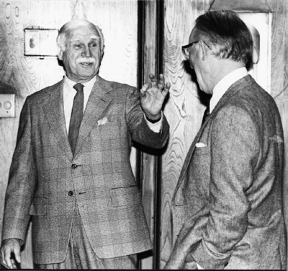 Laverty (left) jokes with former Queen's philosophy professor and department head A.R.C Duncan.