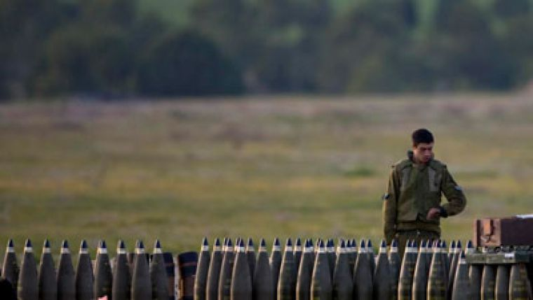 An Israeli soldier inspects munitions. The Israeli Apartheid Week debate stems largely from Israeli military presence and settlement building outside Israel's 1967 borders.