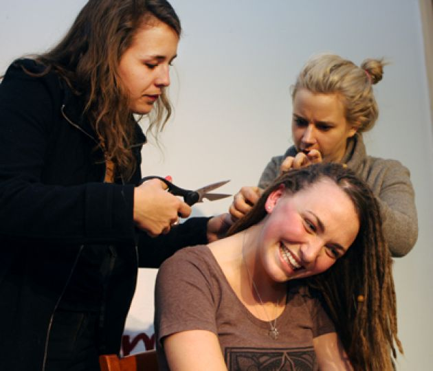 Emma Patterson, ArtSci '11, and Lisbeth Moiseshyn of ECHO Hair Studio give Sarah Connolly, Artsci '11, a new hairstyle at the Common Ground on Wednesday night to raise funds for Queen's Health Outreach.