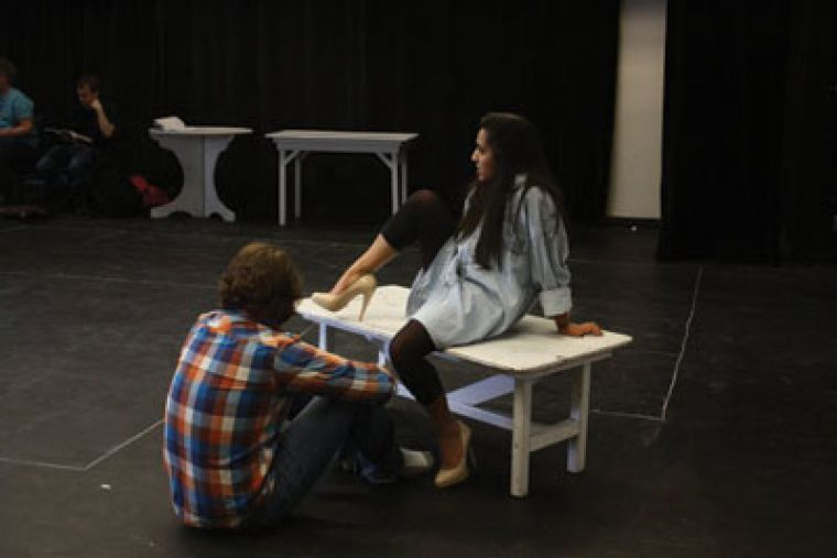 Drew Moore (left) rehearses in his role as detective Stone, hired to find the beautiful bad girl, Mallory, played by Shruti Kothari (right).