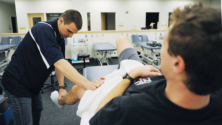 Athletic therapist James Sawchuk works on track and field athlete Shane Kelly at the Athletic Therapy department.