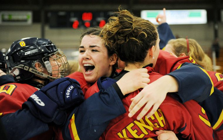 The women's hockey team celebrates their first provinical title in 32 years.