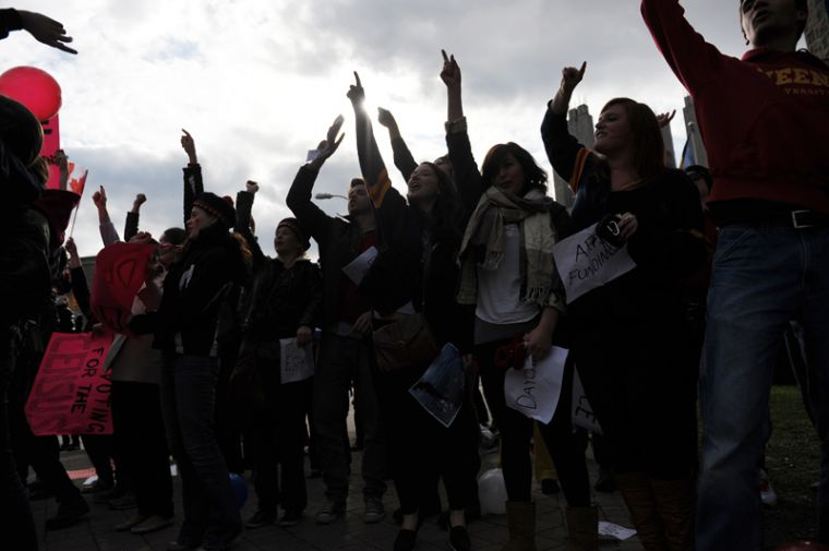 Students perform the Oil Thigh following the end of the Queen's University Vote Mob.