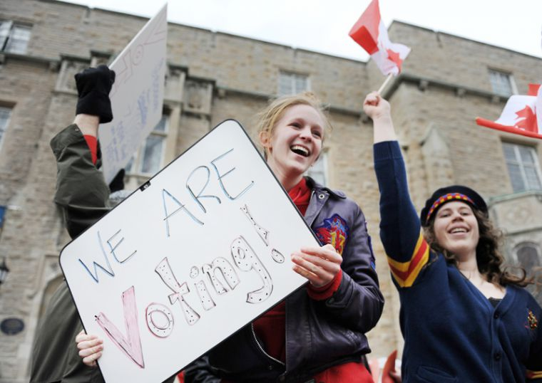 Students held up a variety of signs pledging their participation in the May 2 federal election.