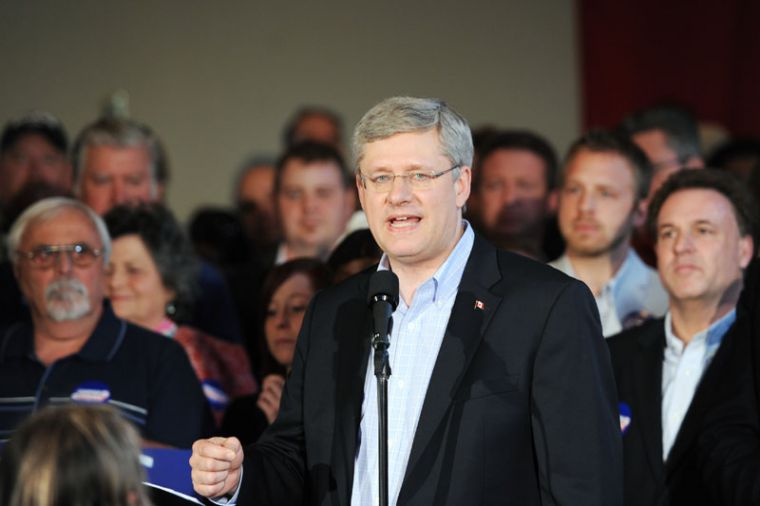 Conservative leader Stephen Harper rallies voters during his whistle stop in Kingston, Ontario.