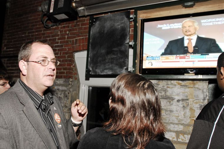 Kingston and the Islands NDP candidate Daniel Beals at the Toucan on Monday night with supporters.