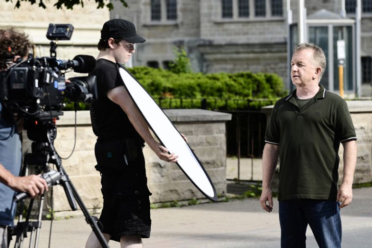 Comedian Ron James and crew film a portion on Queen's for an episode of the Ron James Show that will air this fall on CBC. The crew has been filming across Kingston for the past two days, visiting various locations such as the penitentiary museum.