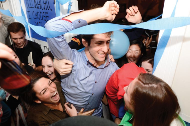Nick Francis, ArtSci '13, celebrating with his supporters after being declared the 33rd rector of Queen's University on Wednesday.