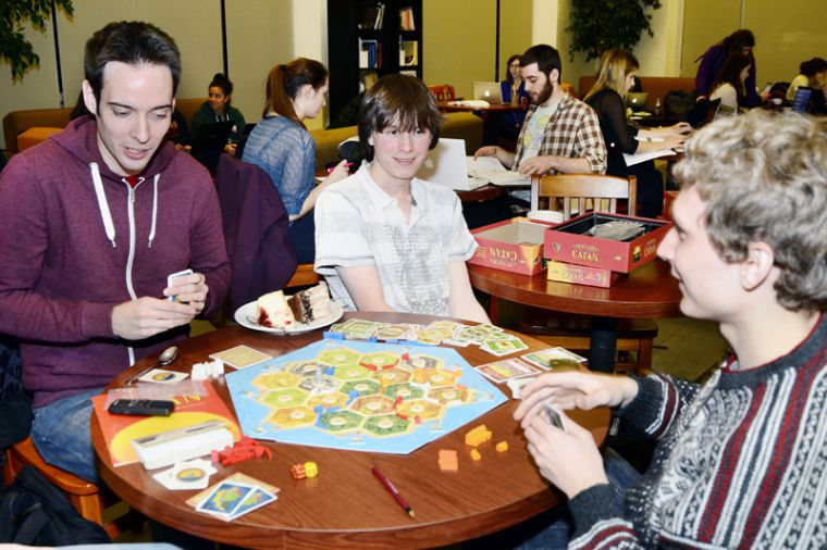 Team RMS plays Settlers of Catan at Common Ground while awaiting election results on Wednesday night.