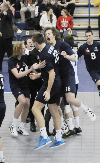 The Trinity Western Spartans celebrate a second straight CIS gold medal on March 4 at the ARC.