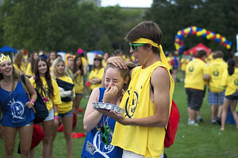 A gael prepares to get pied by one of her frosh during Queen's in the Park