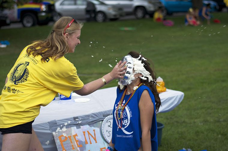 A gael gets a pie to the face during the Queen's in the Park event