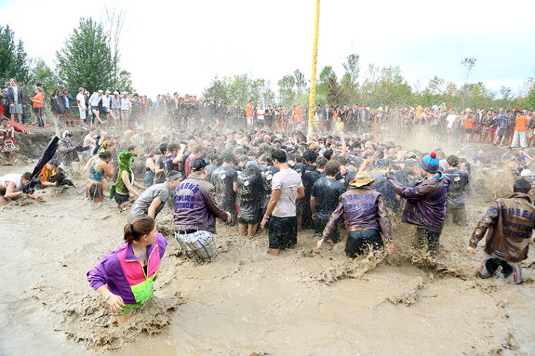 Upper-year engineering students join their frosh counterparts in the mud at the annual Grease Pole event.