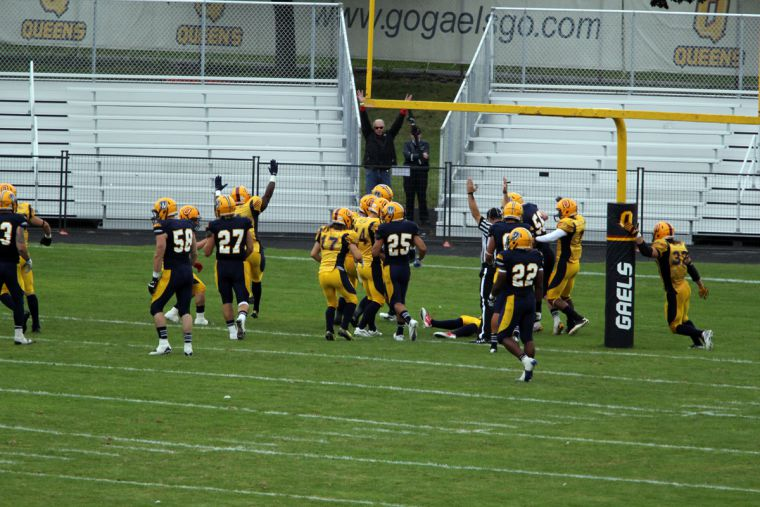 Queen's celebrates running back Jonah Pataki's fumble recovery in the end zone, which came one play after Scott Macdonell's 35-yard touchdown grab.